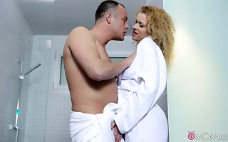 Curly babe gets intimate down at the shower