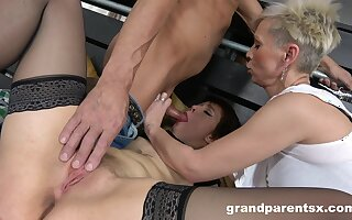 Two short-haired sluts hungrily apportionment a stud's stiff endow with