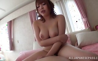Japanese babe gives a titjob with her natural breasts with an increment of rides