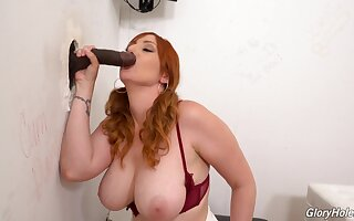 Interracial glory hole action be advisable for busty redhead Lauren Phillips
