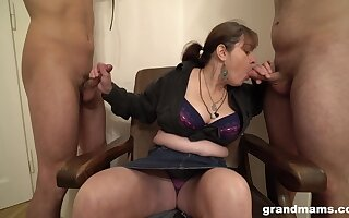 Grown-up German slut wants her slaves to suck her fat chest