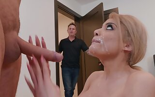 Wife throats and swallows while her hubby is regarding the other room