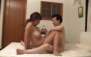 Amateur lovemaking on someone's skin bed all round a chubby Japanese housewife