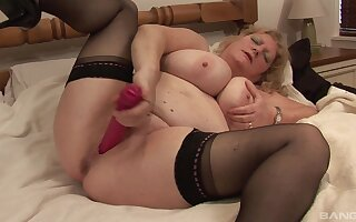 Fat mature blonde woman getting naked and penetrating her cunt