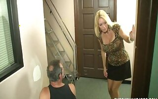 Busty blonde mature Charlee Chase gives a handjob and a titjob