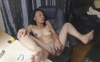 Hot Asian milf strips and masturbates and penetrated