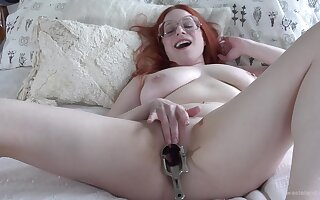 Chubby redhead slut pokes her pussy with a sex toy and moans