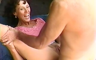 Beautiful mature babe blows younger man