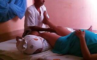 Pregnant woman getting leg massage