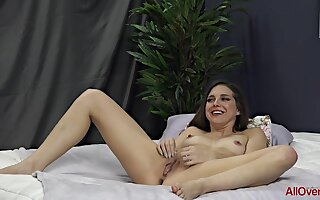 Sadie Holmes is posing for the camera in erotic rags and then effectuation with her pussy