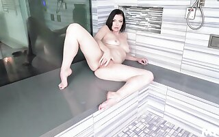 Elegant wife rubs pussy and ass under the warm shower