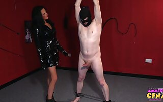 Astonishing woman in a inky dress and cavalier heels is playing with her coitus slaves cock