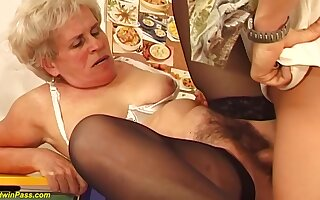 Hairy Hungarian granny is sucking a immensely younger guys dick and procurement fucked hard, in fetch