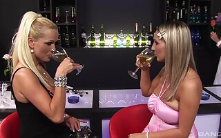 Sharon Pink plus her girlfriends sharing a big cock close by a bar