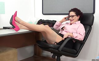 Amanda Ryder whips out her vibrator and has fun with it in the office