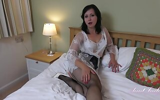 Wanilianna is wearing black fishnets while masturbating in her bedroom, in front of the camera