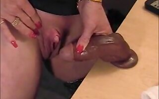 Hot gilf scraping her big clit with gummy dick